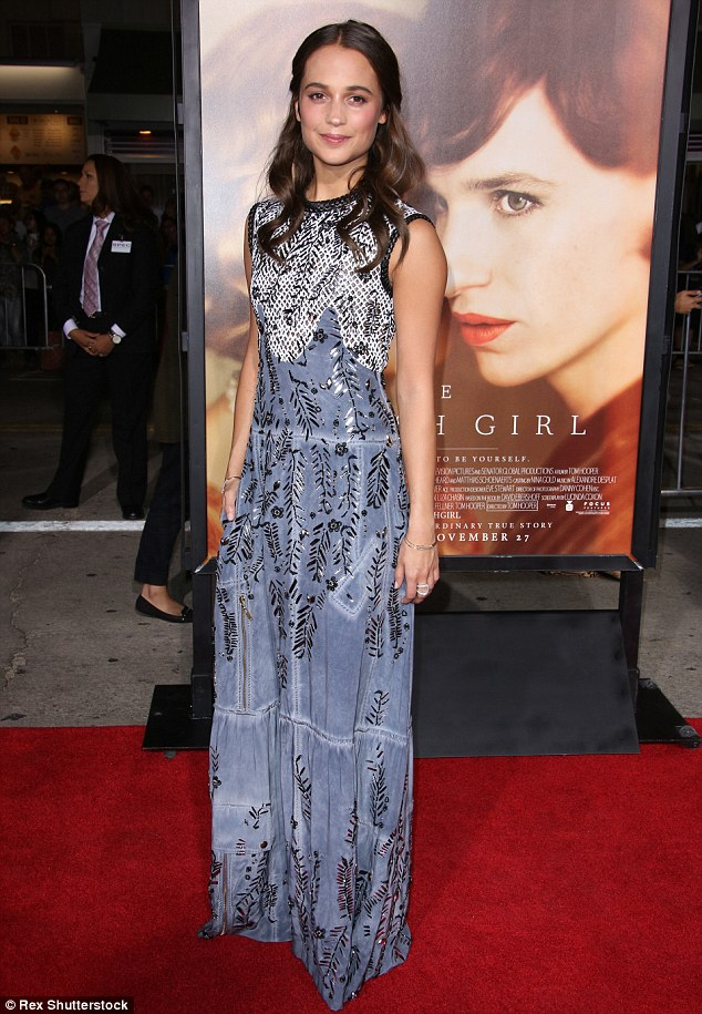 Dazzling in blue: Alicia Vikander's greyish-blue gown featured a detailed network of embroidery