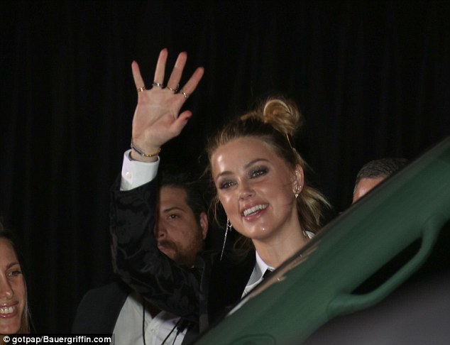 Hello! Amber was the definition of a beaming beauty as she made her way into the event withe a huge smile on her face
