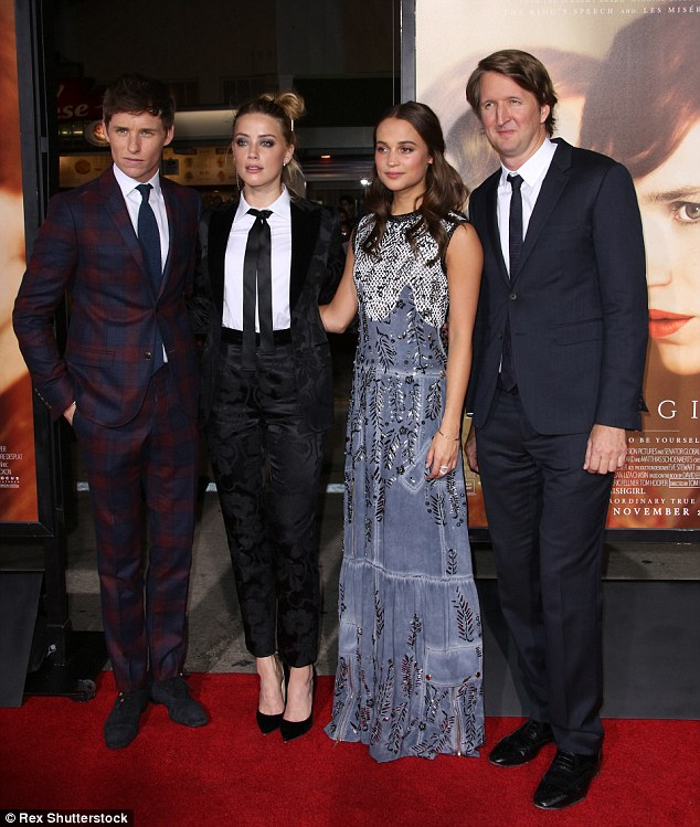 Star turn out: The 29-year-old Texas native posed with the film's stars, L to R, Eddie Redmayne and Alicia Vikander and director Tom Hooper