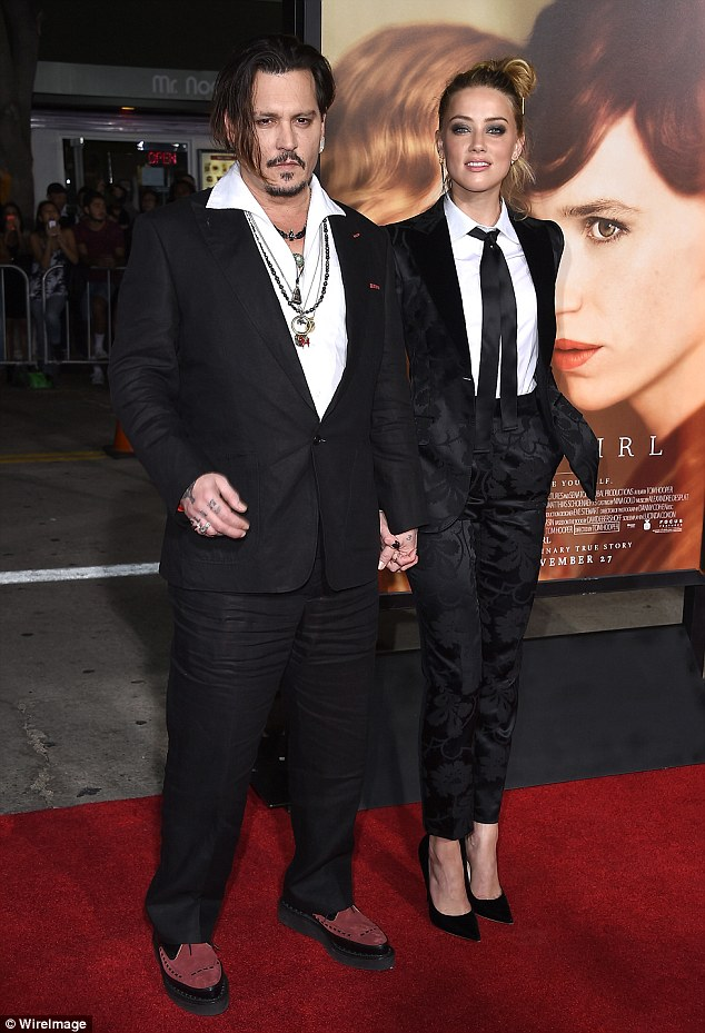 Stylish match: Johnny Depp and Amber Heard were both dressed in gentlemanly attire as they attended the LA premiere of her new film The Danish Girl on Saturday