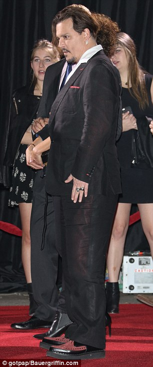Stylish with a twist: Dressed in his own unique style ,Johnny straddled the line between classic black-tie formality and Hollywood boho chic