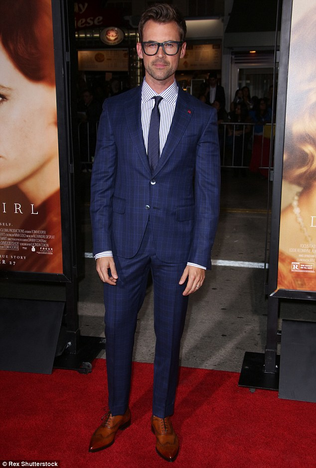 He's got the look too: Brad Goreski looked sharp in a stylish blue suit and brown shoes