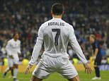 Real Madridís Cristiano Ronaldo celebrates scoring his side's 4th goal during a Champions League group A soccer match between Real Madrid and Malmo at the Santiago Bernabeu stadium in Madrid, Tuesday, Dec. 8, 2015. (AP Photo/Francisco Seco)