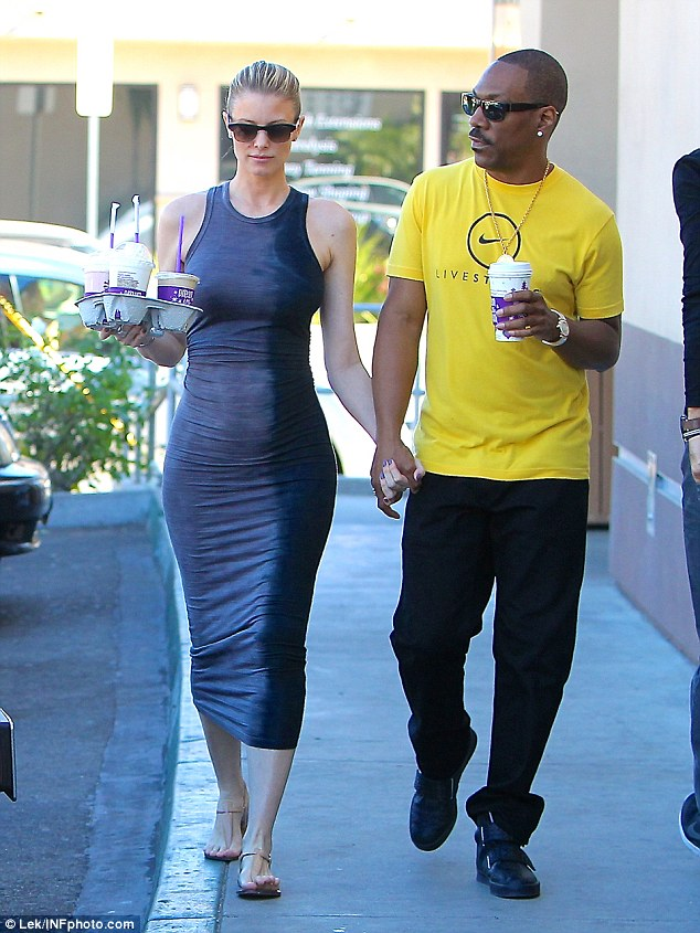 Hand in hand: The 36-year-old looked happy as can be with her movie star boyfriend