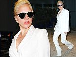 December 10, 2015: Lady Gaga is spotted at JFK airport in New York City. Mandatory Credit: PapJuice/INFphoto.com Ref: infusny-286