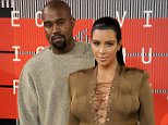 FILE - December 05, 2015: Kim Kardashian has given birth to a baby boy, her second child with Kanye West. LOS ANGELES, CA - AUGUST 30:  Kim Kardashian and Kanye West arrive at the 2015 MTV Video Music Awards at Microsoft Theater on August 30, 2015 in Los Angeles, California.  (Photo by Gregg DeGuire/WireImage)