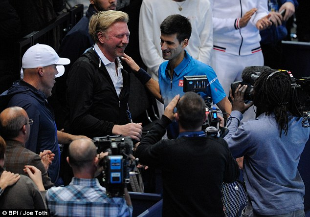 The Serbian world No 1 celebrates his victory over Roger Federer with his coach Boris Becker