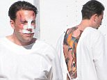 Picture Shows: Ben Affleck  December 08, 2015\n \nActor Ben Affleck is spotted on the set of his new movie 'Live By Night' looking beaten and bruised in Los Angeles, California. \n \n Ben, who was also sporting a large tattoo on his back, was seen enjoying a cigarette outside of his trailer between takes.\n \n ** Min Web / Online Fee £400 For Set **\n \n \n Exclusive All Rounder\n UK RIGHTS ONLY\n Pictures by : FameFlynet UK © 2015\n Tel : +44 (0)20 3551 5049\n Email : info@fameflynet.uk.com