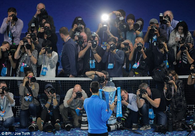 Photographers capture the moment of triumph for Djokovic as he wraps the best year of his career to date