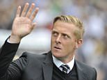 "File photo dated 20-09-2014 of Swansea City manager Garry Monk. PRESS ASSOCIATION Photo. Issue date: Tuesday December 8, 2015. Swansea chairman Huw Jenkins has dropped a strong hint that manager Garry Monk is on his way out of the struggling Barclays Premier League club after declaring that ""something needs to change"". See PA story SOCCER Swansea. Photo credit should read PA Wire/PA Wire."