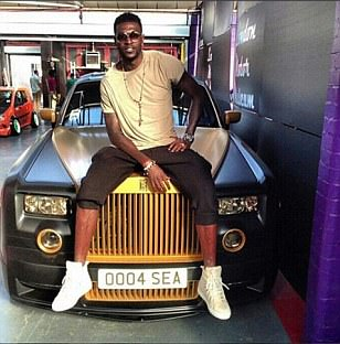Emmanuel Adebayor pictured with personalised Rolls-Royce Phantom Coupe as he continues to