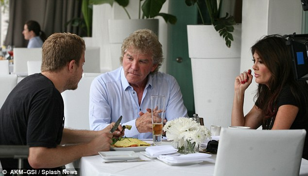 It's all white: Villa Blanca is owned by the British born reality star and her husband Ken Todd, pictured dining with a friend there