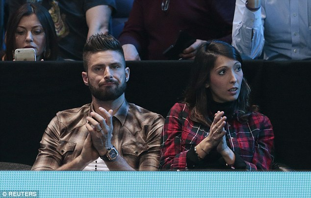 Arsenal striker Olivier Giroud catches some tennis with wife Jennifer after Saturday's loss to West Brom