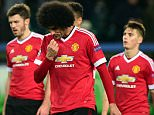 TOPSHOT - (L-R) Manchester United's English midfielder Jesse Lingard (35), Manchester United's Belgian midfielder Marouane Fellaini (27) react after the UEFA Champions League Group B second-leg football match VfL Wolfsburg vs Manchester United in Wolfsburg, central Germany, on December 8, 2015. Manchester United crashed out of the Champions League on Tuesday with a 3-2 defeat at Wolfsburg, who made club history by reaching the knock-out stages. AFP PHOTO / JOHN MACDOUGALL / AFP / JOHN MACDOUGALLJOHN MACDOUGALL/AFP/Getty Images