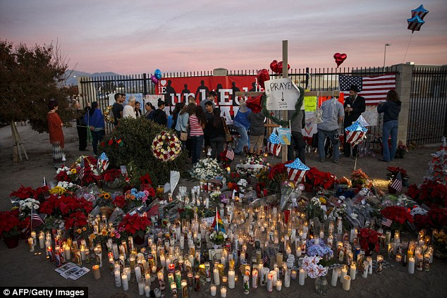 Recent shootings: The PSA called 'We can end gun violence' comes after the horrific shooting in San Bernardino, California last week that killed 14 people and injured 21 others in what authorities say was an act of terrorism. Pictured here is a makeshift memorial following the December 6 act of terror