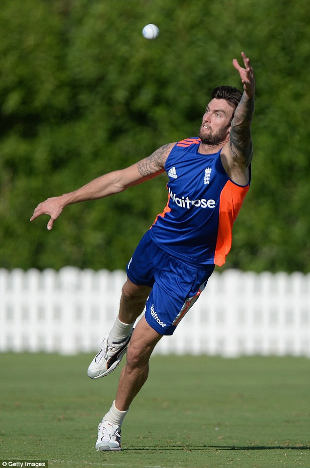 Topley uses his huge frame in the nets as he dives for a left-handed catch