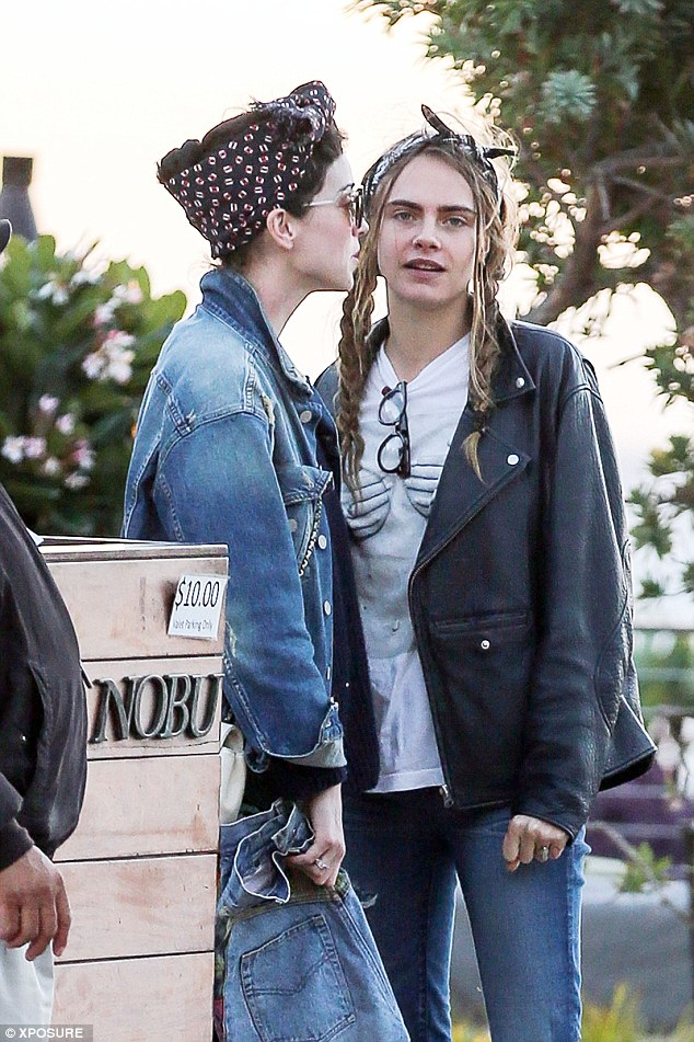 Date night:Cara flaunted her usual edgy style credentials as she sported an over-sized leather biker jacket which drowned her slender model frame as she waited for her car to be fetched from valet parking