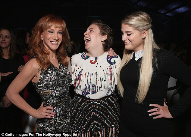 Just for laughs: Lena couldn't stifle her giggles next to Griffin again as they posed with Meghan Trainor