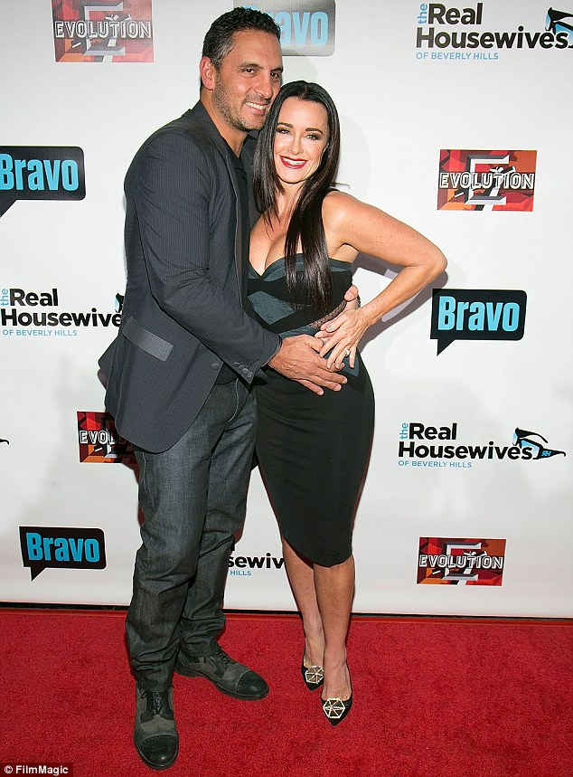 Feud: The reality star's husband Mauricio Umansky (who she is pictured with last week) and two of their daughters were left off the guestlist, apparently because he had a fallout with Nicky's father Rick Hilton