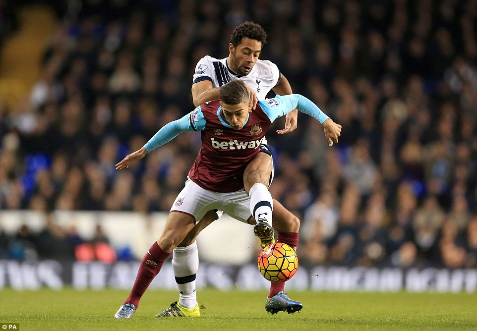 Manuel Lanzini tries to hold off Dembele's challenge as West Ham looked to win at White Hart Lane for the fourth time in five visits