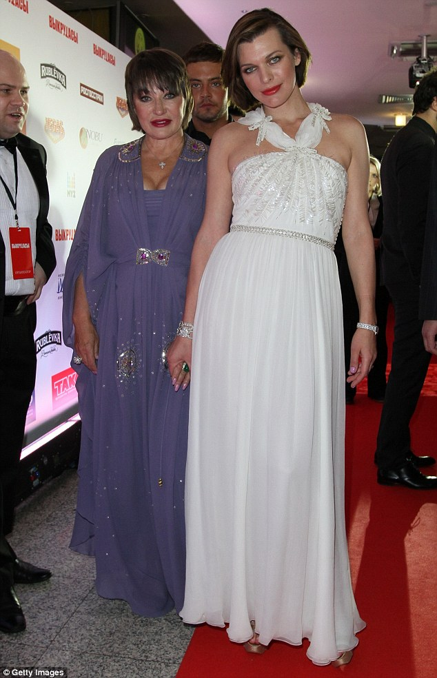 Serious situation:Milla's mother Galina has been receiving calls from a mystery man demanding to talk to her famous daughter and threatening to blow up her house, according to TMZ. Here Milla is seen with her mother in 2011