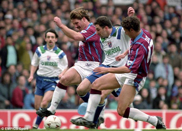 Double trouble: Shaun Teale and Neil Cox try to stop John Aldridge as Pat Nevin looks on