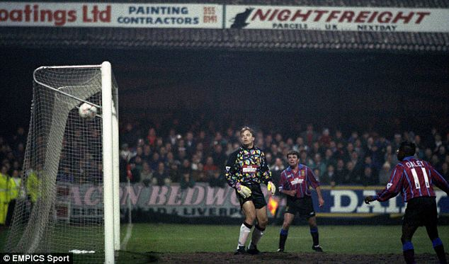 Net loss: Bosnich is beaten by Mark Hughes in the first leg as Tony Daley (right) looks on