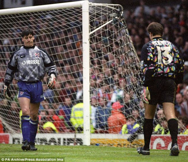 Keep going: The tension mounts in the shootout as Tranmere's Eric Nixon (left) swaps places with Mark Bosnich