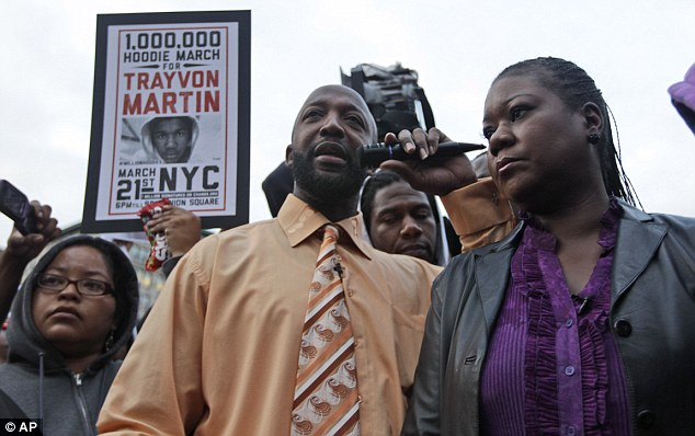 Speaking out: Trayvon Martin's parents Tracy Martin, centre, and Sybrina Fulton, right, took part in the 'Million Hoodie March' in New York's Union Square today