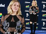 Mandatory Credit: Photo by Agencia EFE/REX Shutterstock (5491152f)\n Ellie Goulding poses with her best new international artist award and best international song 'Love me like you do'\n 40 Principales Gala Awards, Madrid, Spain - 11 Dec 2015\n \n