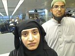 Tashfeen Malik, (L), and Syed Farook are pictured passing through Chicago's O'Hare International Airport in this July 27, 2014 handout file photo. A couple who massacred 14 people at a California holiday party were discussing martyrdom online before they met in person and married, FBI Director James Comey said on December 9, 2015.  REUTERS/U.S. Customs and Border Protection/Handout   THIS IMAGE HAS BEEN SUPPLIED BY A THIRD PARTY. IT IS DISTRIBUTED, EXACTLY AS RECEIVED BY REUTERS, AS A SERVICE TO CLIENTS. FOR EDITORIAL USE ONLY. NOT FOR SALE FOR MARKETING OR ADVERTISING CAMPAIGNS
