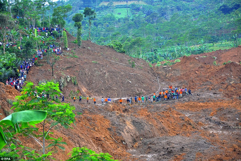Indonesian rescuers search for victims after the landslide hit. More than 2,000 people were involved in rescue efforts. Millions of people in the country live in mountainous areas or near flood-prone plains close to rivers
