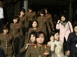 Members from North Korea's Moranbong band walk out of their hotel in Beijing on December 11, 2015 ©STR (AFP)