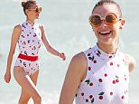 145977, Jaime King shows off her slender figure in a retro cherry print swimsuit on the beach in Miami. The new mom showed off her stunning figure this afternoon as she joined her husband Kyle Newman and sons Leo and James Knight on the beach. Miami, Florida - Saturday December 12, 2015. Photograph: Brett Kaffee, © Pacific Coast News. Los Angeles Office: +1 310.822.0419 sales@pacificcoastnews.com FEE MUST BE AGREED PRIOR TO USAGE