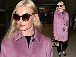 Kate Bosworth arrives at LAX in Large Pink Coat  Pictured: Kate Bosworth Ref: SPL1192489  101215   Picture by: MONEY$HOT / Splash News  Splash News and Pictures Los Angeles: 310-821-2666 New York: 212-619-2666 London: 870-934-2666 photodesk@splashnews.com