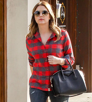 Casual in plaid: Pretty Little Liars star Ashley Benson was rocking a checked shirt and ripped jeans as she headed out and about in Beverly Hills.