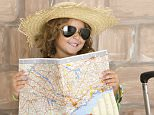 Child wearing sunglasses reads a map.