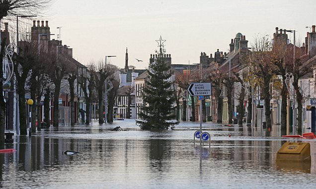 The great Christmas clean-up: As Cumbria is struck by floods again, we help to tackle the
