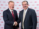 Edward D. Breen (L), chairman and chief executive officer of DuPont, is pictured shaking hands with Andrew N. Liveris, Dow?¢?Ǩ?Ñ¢s chairman and chief executive officer, in this undated handout photo provided by DuPont. Chemical giants DuPont and Dow Chemical Co agreed to merge in an all-stock deal valuing the combined company at $130 billion, with plans to eventually split into three. REUTERS/DuPont/Handout via Reuters      TPX IMAGES OF THE DAY     ATTENTION EDITORS -  THIS IMAGE HAS BEEN SUPPLIED BY A THIRD PARTY. IT IS DISTRIBUTED, EXACTLY AS RECEIVED BY REUTERS, AS A SERVICE TO CLIENTS. FOR EDITORIAL USE ONLY. NOT FOR SALE FOR MARKETING OR ADVERTISING CAMPAIGNS. EDITORIAL USE ONLY. NO RESALES. NO ARCHIVE.