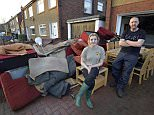 Dated: 07/12/2015 Brian Coopland who lives on Eden Park Crescent in Carlisle with his daughter Toni pictured on their driveway amongst the stripped out contents of their home which was flooded on Sunday morning. FAO Janet, Mail picture desk.