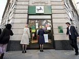 """Pedestrian walk past a branch of a Lloyds bank in central London, England.  Britain's state-rescued Lloyds Banking Group said on July 31, 2015, that net profits rose by 31 percent in the first half, despite setting aside further funds to compensate customers who were mis-sold insurance. Horta-Osorio said the lender was focused on becoming """"the best bank for customers and shareholders while at the same time supporting the UK economy"""".    AFP PHOTO/LEON NEAL        (Photo credit should read LEON NEAL/AFP/Getty Images)"""