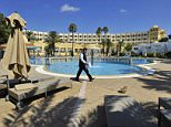 Tunisian I.S. terror attack  - A waiter walks amongst rows of empty sun loungers around the pool at the Riu Palace Oceana Hotel in Hammamet, Tunisia.