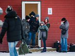 Refugees are welcomed upon arrival at the Norwegian border crossing station at Storskog after crossing the border from Russia on November 12, 2015 near Kirkenes. An increasingly popular route for migrants across Russia and into Norway has Oslo angered and worried as winter approaches, while commentators suspect Moscow is deliberately creating problems for its neighbour.       AFP PHOTO / JONATHAN NACKSTRAND        (Photo credit should read JONATHAN NACKSTRAND/AFP/Getty Images)