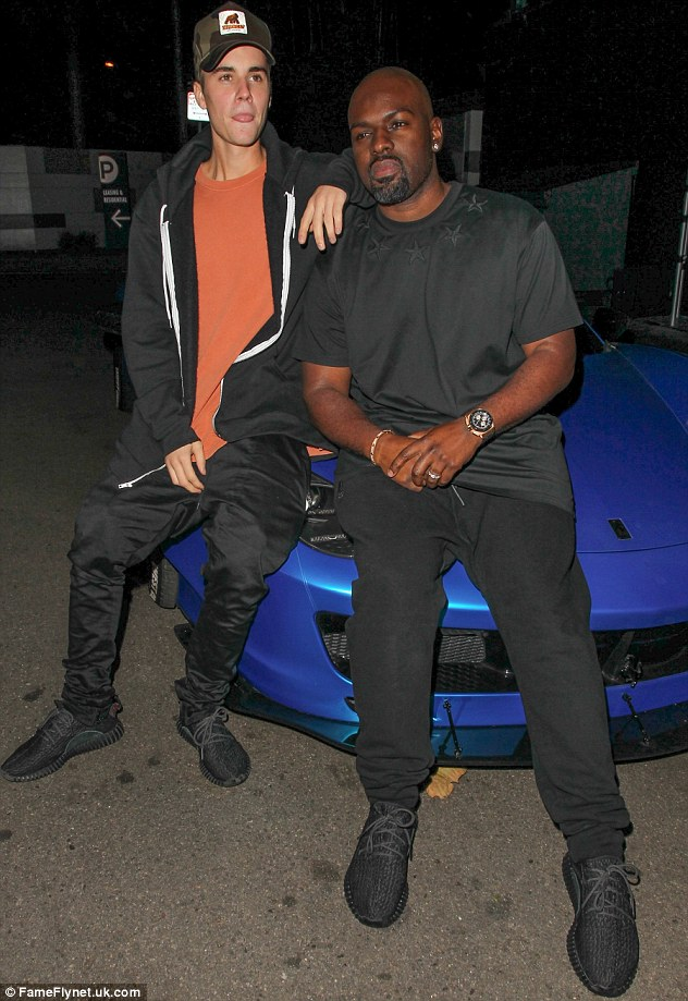 Toyboys united: Justin posed up on his hideously customised Ferrari with Kris Jenner's lover Corey Gamble