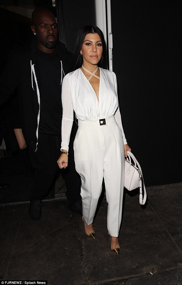 All white on the night:Kourtney Kardashian strengthened reports she is not back with her ex Scott Disick as she put on a glamorous display to fly solo at The Nice Guy in West Hollywood on Friday night