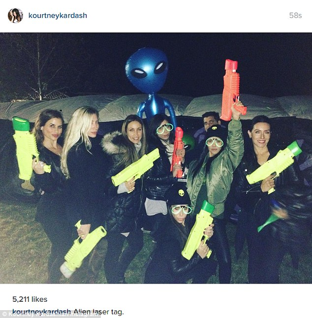 'Alien laser tag': Men were the last thing on Kourtney's mind on Saturday, as she enjoyed a wacky night with friends