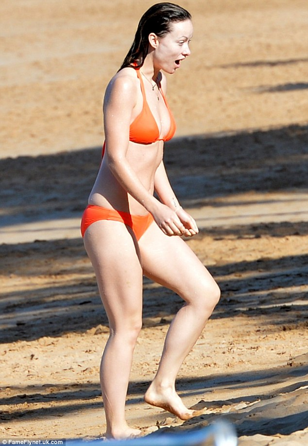 Hawaii is it so cold: Olivia Wilde looked like she was feeling the chill after taking a dip in the sea at the tropical paradise on Saturday