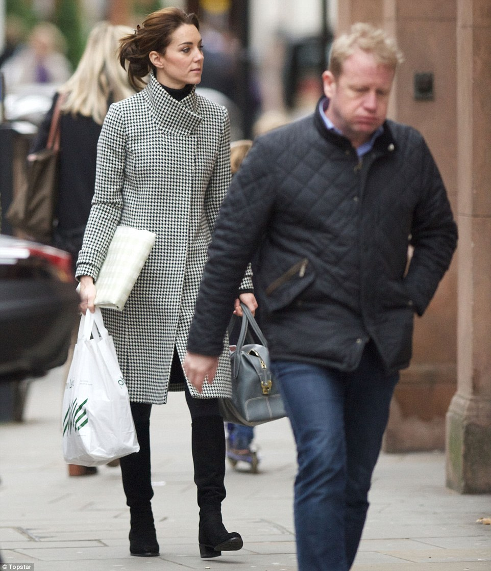 Wrapping up for winter: Kate chose a practical pair of black suede boots for the trip - perfect for strolling around the shops