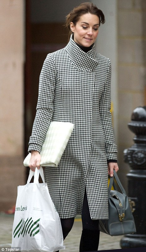 Good spirits: The Duchess, who appeared to be carrying a checked tablecloth under one arm, looked relaxed as she shopped on Friday