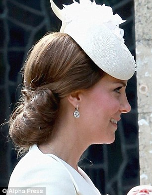 All white: At Charlotte's christening - she will be set to inherit some enviable genes